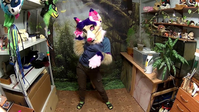 Fursuit saber-toothed flying fox.