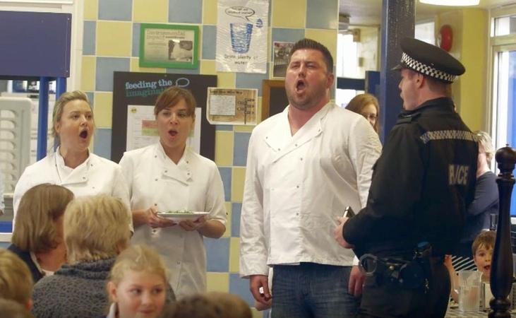 Opera singers sing for schoolchildren at lunch
