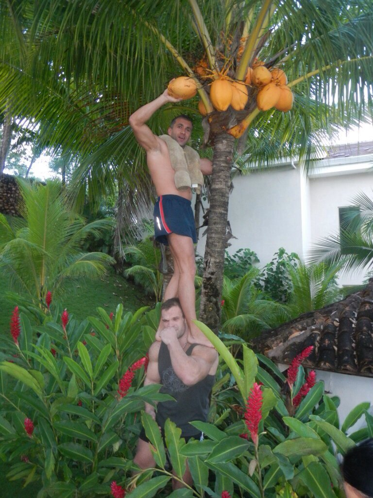 Denis Cyplenkov with a guy on his shoulders who picks Cacao Pods / Cacao Beans / Cocoa Beans │ Photo Source: Trec Nutrition. Sports Nutrition