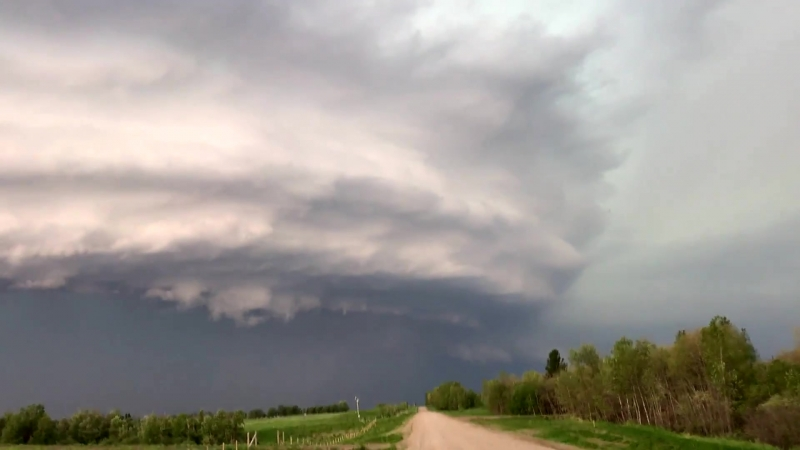 NEW mothership supercells at northern reach of North American road grid west of Cold Lake, Alberta!
