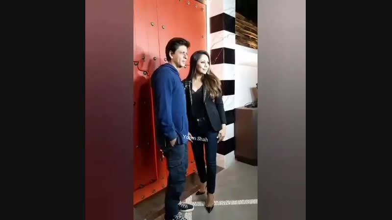 Shahrukhkhan poses with wife gaurikhan for media where he was bumped to visit the sanchosrestaurant Which is been Designed b