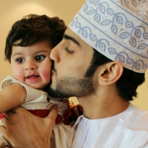 Muslim Father kissing beautiful baby