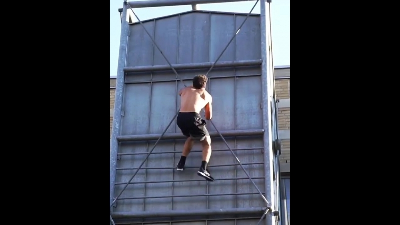 Lad climbs up the side of a building really fast
