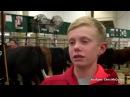 Boy gets stuck between two cows