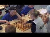 Girl making a brilliant move in English checkers