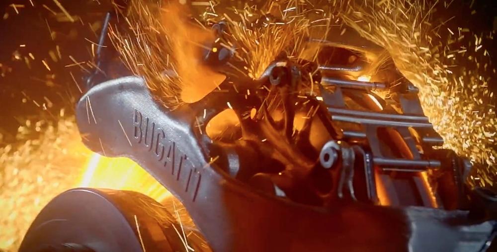 Инженеры Бугатти наспечатали титановый суппорт (видео)