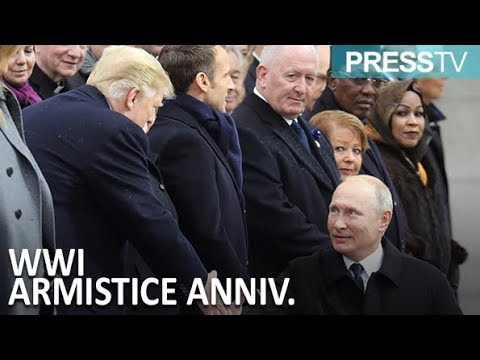 Putin shakes hands with Trump at WWI Armistice ceremony