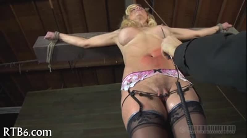 Lovely beauty receives facial torture during bdsm play