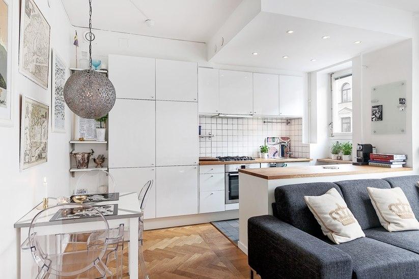 Квартира-студия 36 м в Европе с четким зонированием комнаты на кухню, гостиную и спальню.