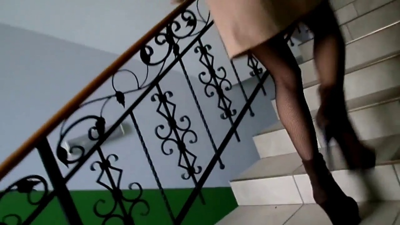 Legs in stockings under the coat, walk on the steps