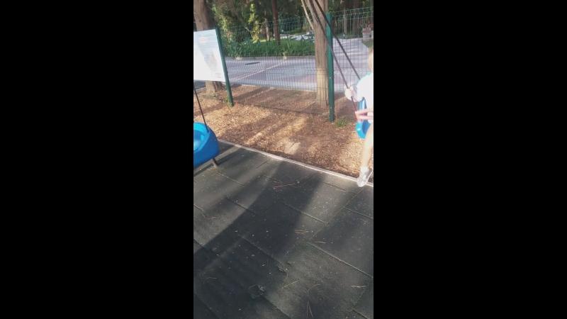 Лева качается на детской площадке санатория Южные ворота