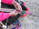 Weaving a belt with a backstrap loom near Cuzco