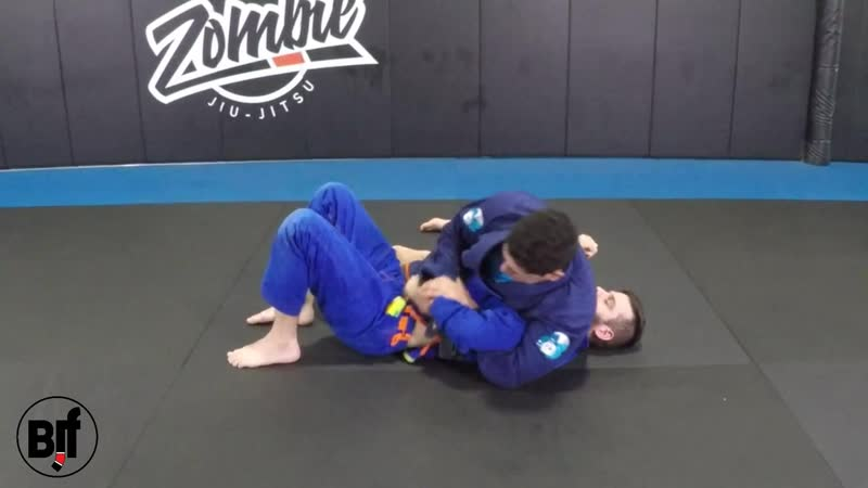 Defending kimura from bottom half guard