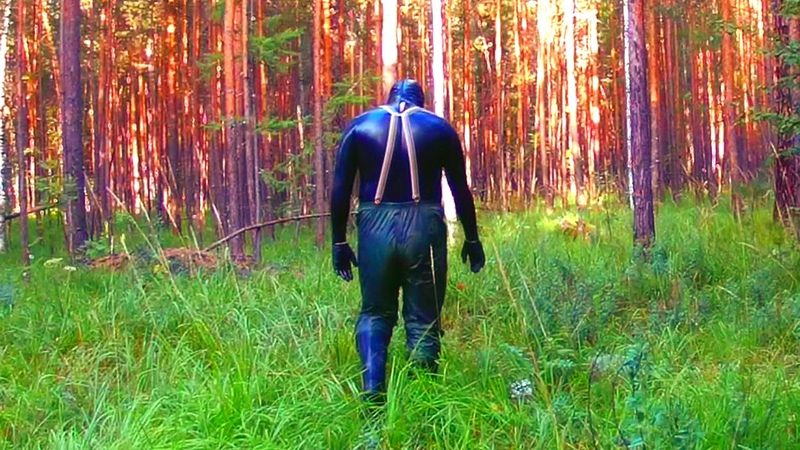 Man in Latex Catsuit at forest