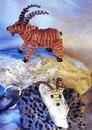 Схема плетения Козерога.  Симпатичный объемный Козерог и маленький брелок в виде головы с рогами.
