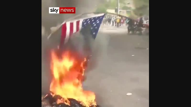 Protesting Haitians burn US flag, ask Russia to help resolve crisis