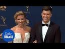Scarlett Johansson and Emmy host Colin Jost on red carpet