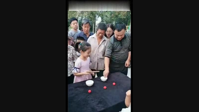 Little girl shows an upclose magic trick