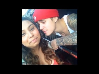 Justin Bieber in a red beanie meeting & kissing fans in Los Angeles - August 10, 2014