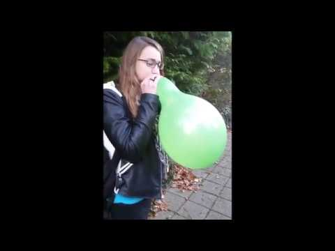 Girl blow to pop green balloon cheating