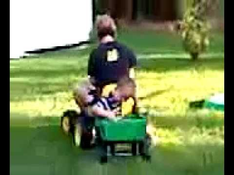 Mom driving power wheels tractor