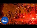 Rowdy fans throw debris at police in Paris after France win - Daily Mail