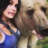 Russian cosplay model took a picture with a bear