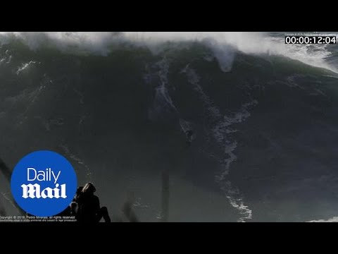 Surfer gets wiped out by a gnarly 60 FOOT WAVE!