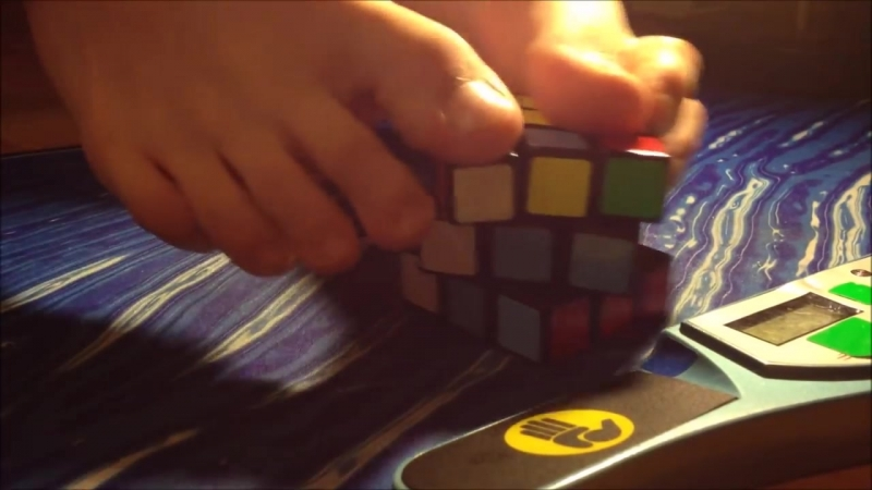 Danish Boy solving Rubiks Cube with his feet.