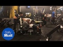 Spotter trips and falls on gym pal bench pressing