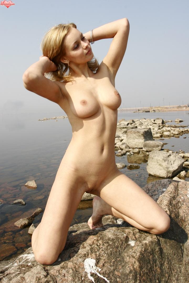 Rubbing lotion on my big tits