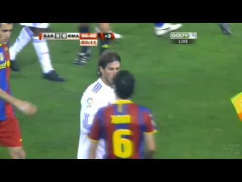 10. Ramos punches Puyol Xavi