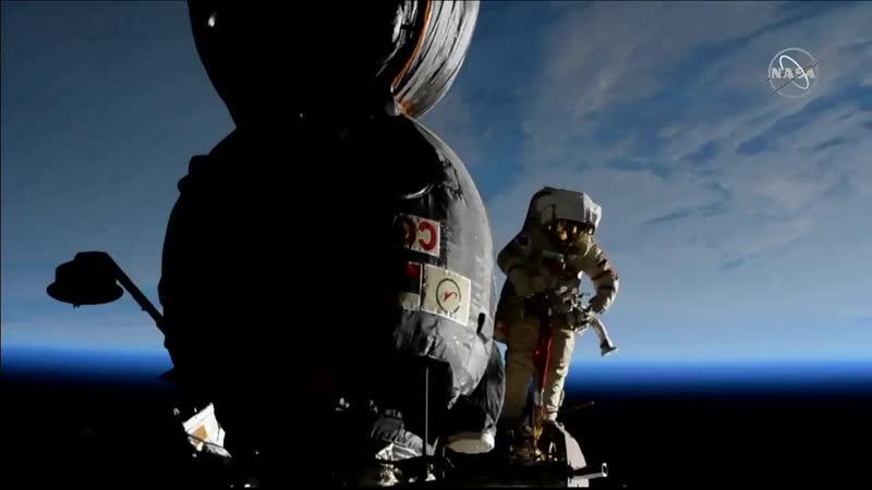 Spacewalker Oleg Kononenko is outside the Soyuz orbital module preparing to begin inspecti