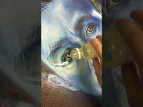 Varnishing an oil painting Dolphin