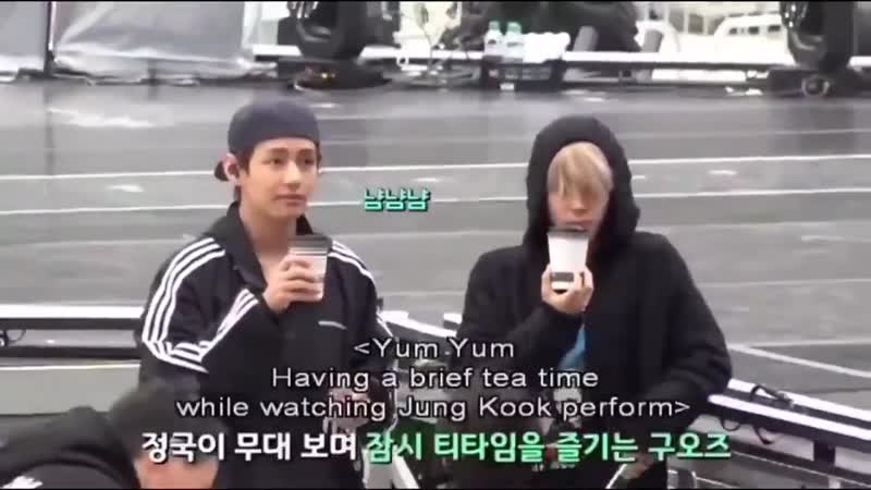 Jimin and taehyung drinking their tea in sync while watching jungkooks rehearsals -