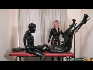 Mistress in latex with two latex dolls part 2