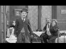 Застигнутый дождем (Чарли Чаплин).