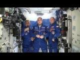 Космонавты поздравляют россиян с Днем флага России