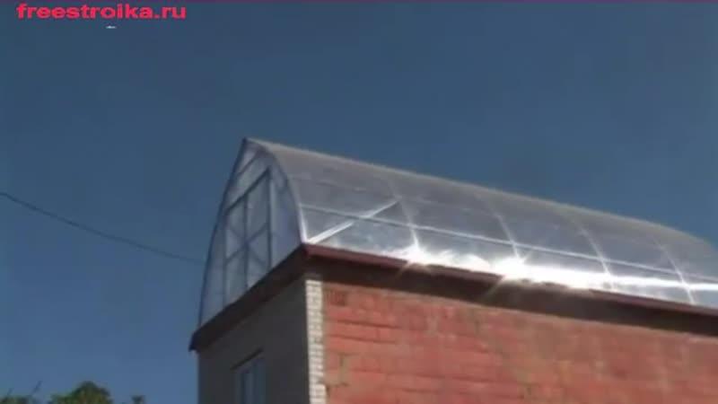 Промышленная теплица Фермер от компании Воля на крыше двухэтажного здания.