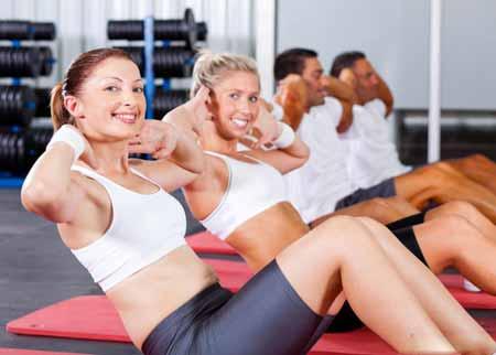 Чрезмерная физическая нагрузка может вызвать боль в спине и животе