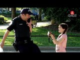 Cop Forces Little Girl to Pick Up a Snake