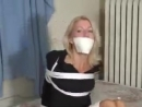 BoundHub - Leggy blonde in black dress in bondage