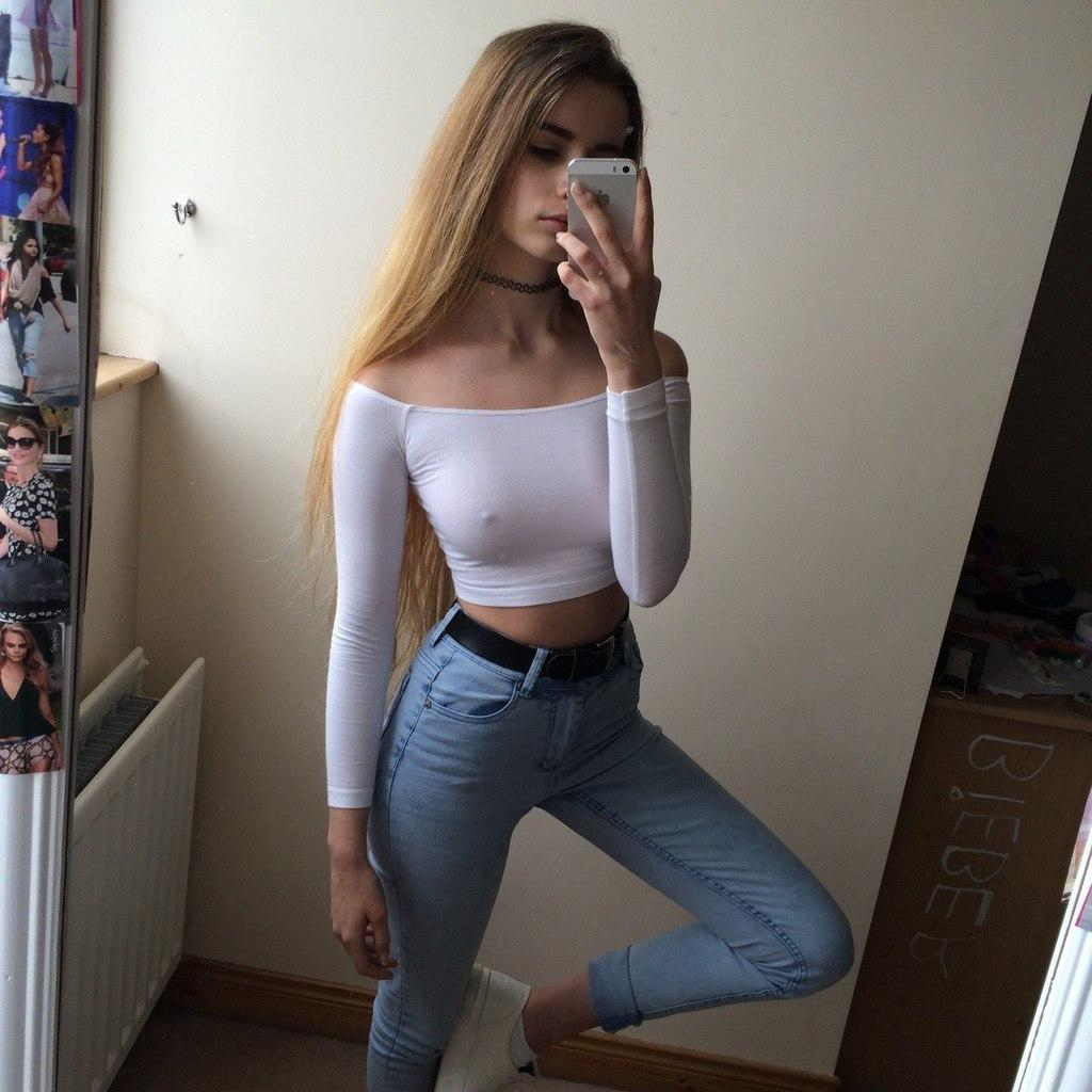 Busty schoolgirl in skirt shows her body