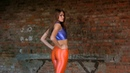 Natasha in skin-tight shiny spandex