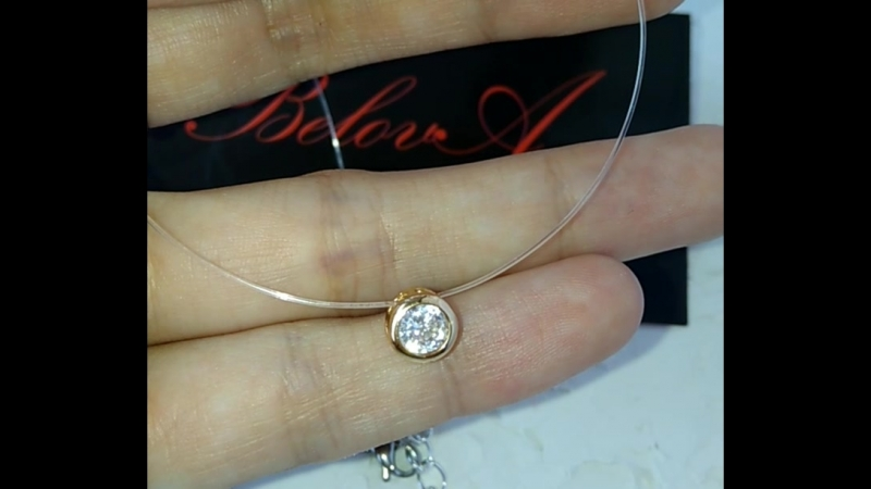 Колье-невидимка с цирконом в золотистой шайбе