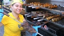 Brazil Street Food. Roasting Huge Skewers and Meat on Grill