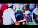 Young fan gets a high five from Rory McIlroy