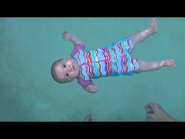 Baby swimming - floating unassisted at 5 months old