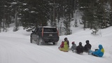 Extreme Sledding in the Rocky Mountains with a Cadillac Escalade