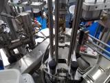Сырная банка КНС 200г от Мира упаковки на автомате роторного типа Пастпак Р пр-ва Таурас-Феникс